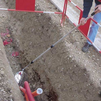 Vialux 321 Extra Long Portable Security Inspection Mirror 300mm Diameter + LED Torch being used in a Trench