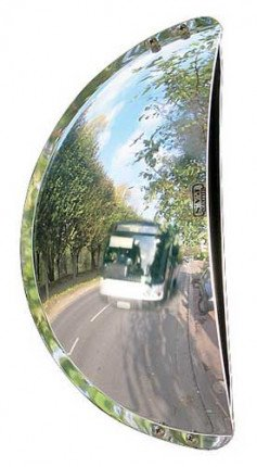 Wide Angle mirror installed on static object giving ability to view busy road